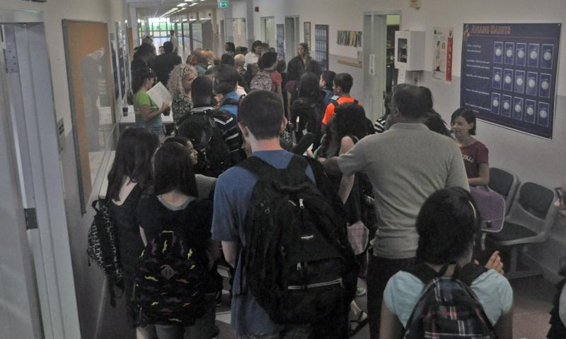 Students, parents and teachers crowd the hallways at Aviano High/Middle School as they head to their classrooms August 26, 2013, to start their first day of school this year at Aviano Air Base, Italy. (Jason Duhr/Stars and Stripes)