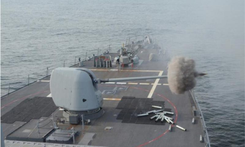 The USS Curtis Wilbur fires its Mark 45 5-inch gun on April 16, 2013, while at sea, east of Japan, during preparations for an upcoming Navy Board of Inspection and Survey review. The destroyer is one of the Navy's ballistic missile defense-capable ships based in Japan, and could be among the first to know if North Korea were to launch a ballistic missile. (Erik Slavin/Stars and Stripes)