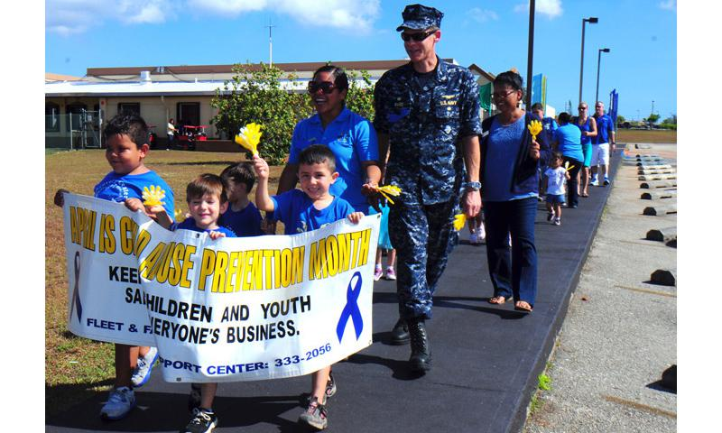 SANTA RITA, Guam (April 26, 2013) - Capt. Mike Ward, commanding officer of U.S. Naval Base Guam (NBG), walks with children, parents, Fleet and Family Support Center (FFSC) and Child Development Center (CDC) staff during the Second Annual Walk for Children event in front of the CDC on base April 26. The walk was an FFSC outreach event to promote April as Child Abuse Prevention Month. (U.S. Navy photo by Mass Communication Specialist 2nd Class Jeremy Starr/Released)