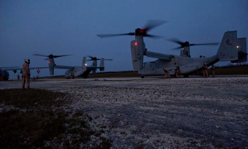 Marines refuel two MV-22B Ospreys during a ground refueling exercise on Ie Shima Airfield in Okinawa on April 15, 2013. (Ian McMahon/U.S. Marines Corps)
