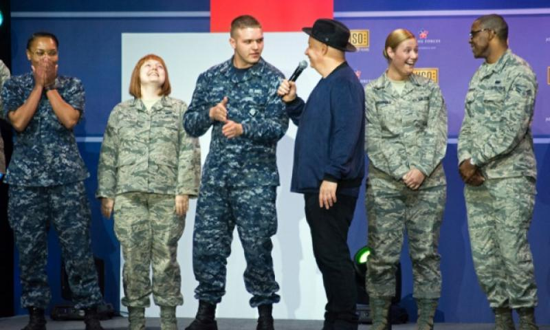"Jeff Ross, an American stand-up comedian known as the Roast Master General, interacts with servicemembers during ""A Celebration of Service,"" a comedy show presented by the USO, for Military Appreciation Month at Andrews Air Force Base on May 5, 2016. (Meredith Tibbetts/Stars and Stripes)"