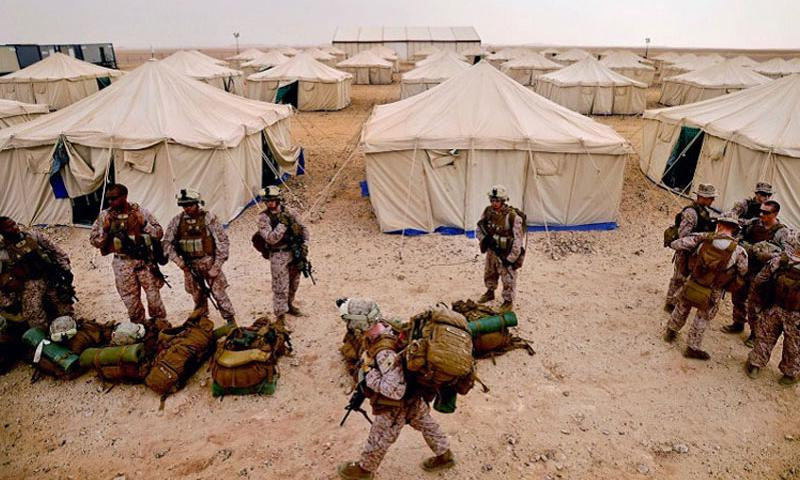 U.S. Marine Corps members assigned unload their gear near their living quarters after arriving at Camp Al-Galail, Qatar, for Exercise Eagle Resolve 2013, April 21, 2014. Qatar was recently removed from the imminent danger pay location list but troops deployed there will still qualify for R&R, according to a recent Pentagon decision. (KENNY HOLSTON/U.S. AIR FORCE)