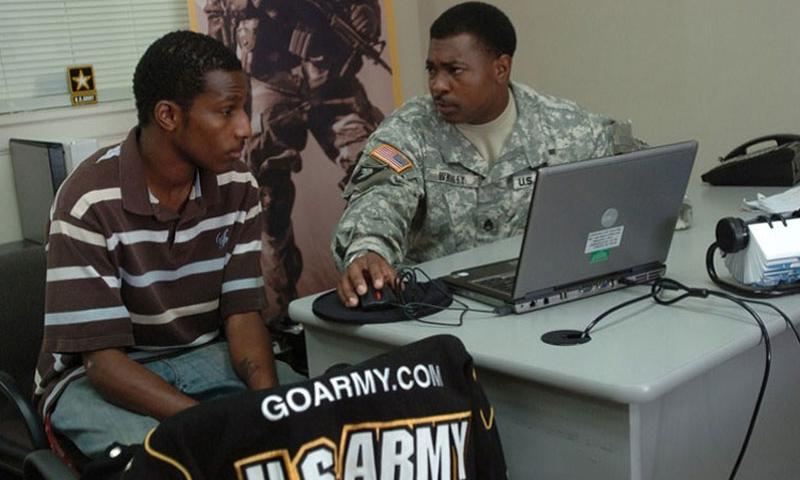 Staff Sgt. Roger L. Whaley speaks with Phillip McDonald about the possibility of becoming a journalist or X-ray technician at the U.S. Army Recruiting Station in Radcliff, Kentucky, in this September 2008 Army file photo. (CARL N. HUDSON/U.S. ARMY)