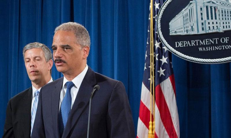 U.S. Attorney General Eric Holder, right, speaks at a press conference with Secretary of Education Arne Duncan on May 13, 2014, to discuss the Department of Justice filing a lawsuit involving student loans under the Servicemembers Civil Relief Act. (MEREDITH TIBBETTS/STARS AND STRIPES)