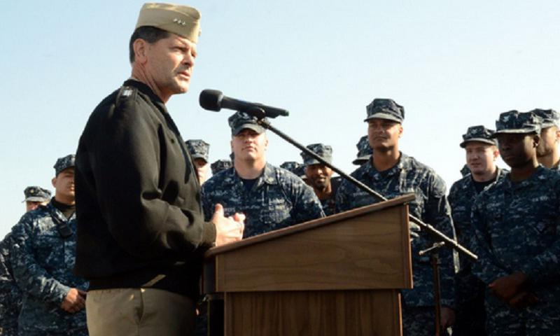 Vice Adm. William F. Moran, Chief of Naval Personnel, speaks to Sailors during an all-hands call aboard USS Fort McHenry (LSD 43).