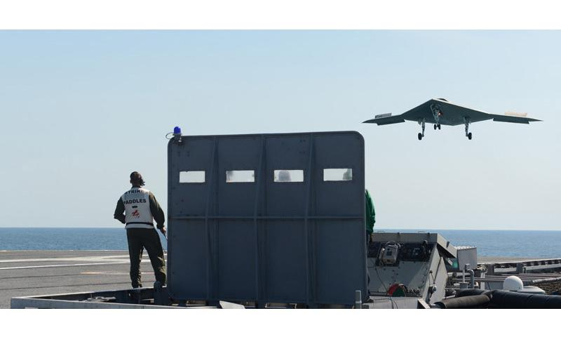 ATLANTIC OCEAN (May 17, 2013) An X-47B unmanned combat air system (UCAS) demonstrator prepares to execute a touch and go landing on the flight deck of the aircraft carrier USS George H.W. Bush (CVN 77). (U.S. Navy photo by Mass Communication Specialist 2nd Class Timothy Walter/Released)