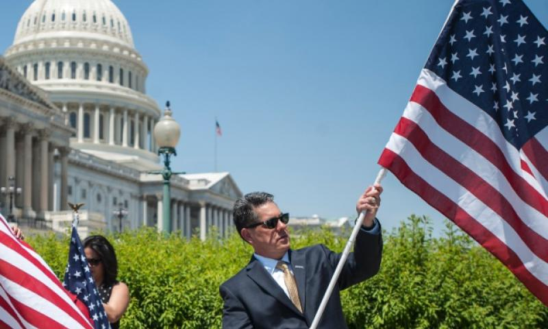 Flags are unfurled during an event at the Capitol in Washington, D.C., on Wednesday, May 17, 2017. On Thursday, 35 veterans groups came together in Washington to reach some consensus on changes to the Post-9/11 GI Bill and restart their activity on Capitol Hill. (CARLOS BONGIOANNI/STARS AND STRIPES)