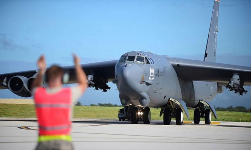 A U.S. airman directs a B-52 Stratofortress at Andersen Air Force Base, Guam, March 21, 2016. Joshua Smoot U.S. Air Force (Joshua Smoot/U.S. Air Force)