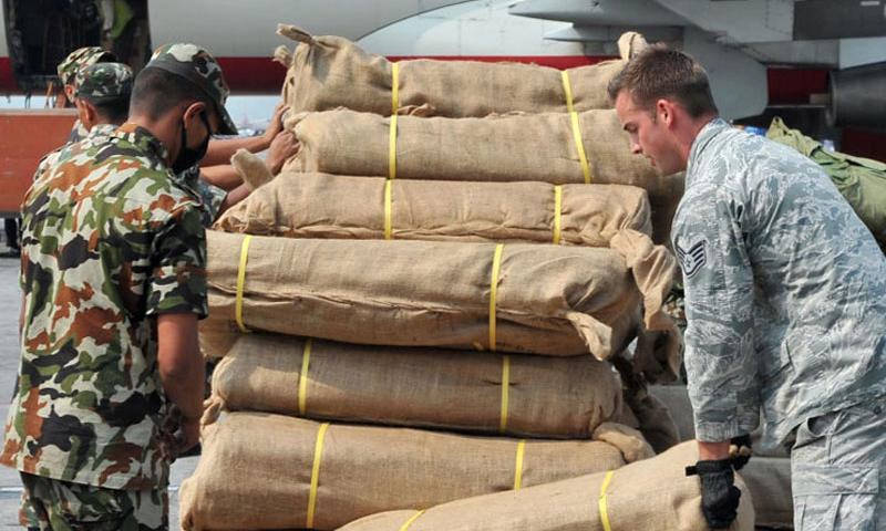 A Nepalese soldier and Staff Sgt. Josh Foley, 36th Mobility Response Squadron aerial port supervisor, move relief supplies May 7, 2015, at the Kathmandu international airport in Nepal. The U.S. military has ended the aid mission it launched in Nepal following last month's earthquake and personnel are in the process of leaving the country. (Melissa White/Courtesy U.S. Air Force)