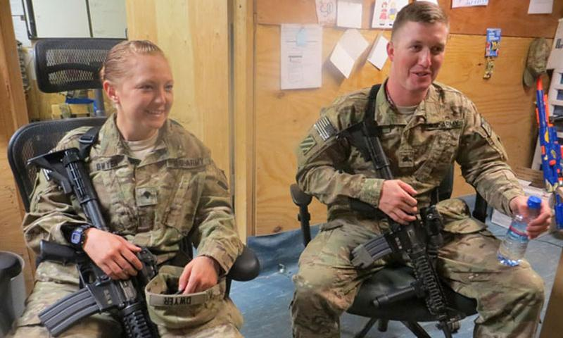 Married couple Spc. Amanda Dwyer and Sgt. Jonathan Dwyer, with the Special Troops Battalion, 4th Brigade Combat Team, spent more than half their 12 months together at Forward Operating Base Shank in eastern Afghanistan in 2013. (Martin Kuz/Special to Stars and Stripes)