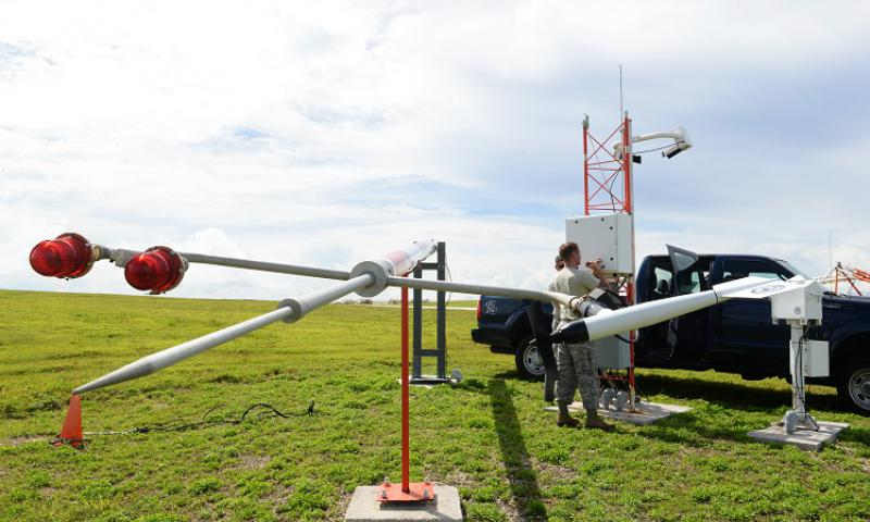Airfield systems Airmen from the 36th Operations Support Squadron open a field data collection unit June 2, 2015, at Andersen Air Force Base, Guam. The technicians check circuits within the unit for arch burns, blown fuses, loose wires and missing parts to ensure life-saving equipment is operational at all times. (U.S. Air Force photo by Senior Airman Amanda Morris/Released)