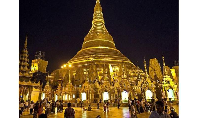 Locals and foreign tourists are drawn to the gold-shimmering Schwedagon Pagoda in Yangon at night. It is Myanmar's holiest Buddhist site. (Photo by Wyatt Olson / Stars and Stripes)