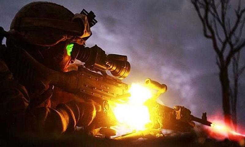 Pfc. Sebastian Rodriguez, a machine-gunner with the Marine Corps rotational force in Darwin, Australia, fires his weapon during a night exercise in May 2013. (Sarah Fiocco/Courtesy of the U.S. Marine Corps)