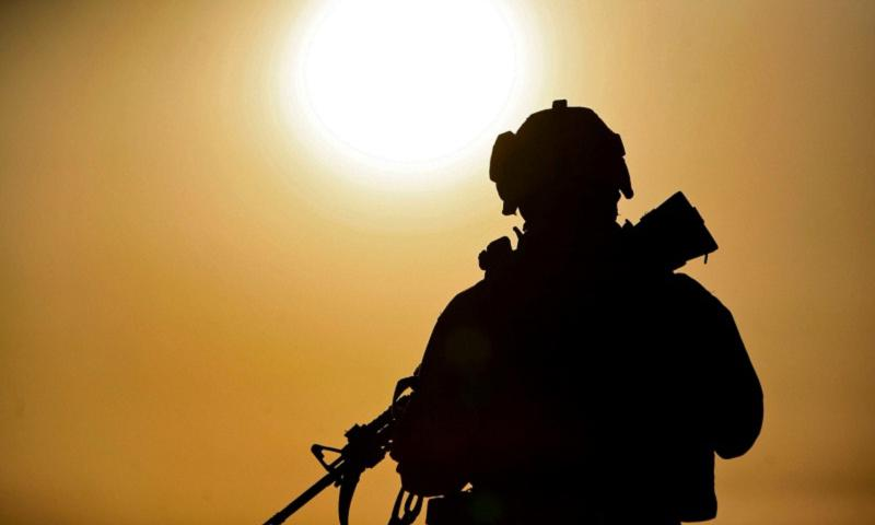 Marine Sgt. Michael J. Beaver on patrol in Salah Ad Din, Iraq in May 2008. (Jason W. Fudge/Courtesy U.S. Marine Corps)