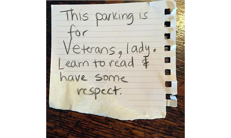 This note was left on a car of a Harris Teeter customer who parked in a spot reserved for veterans. The customer, a Navy veteran, was a little annoyed with the note and posted it and her comments on her Facebook page. (Facebook)