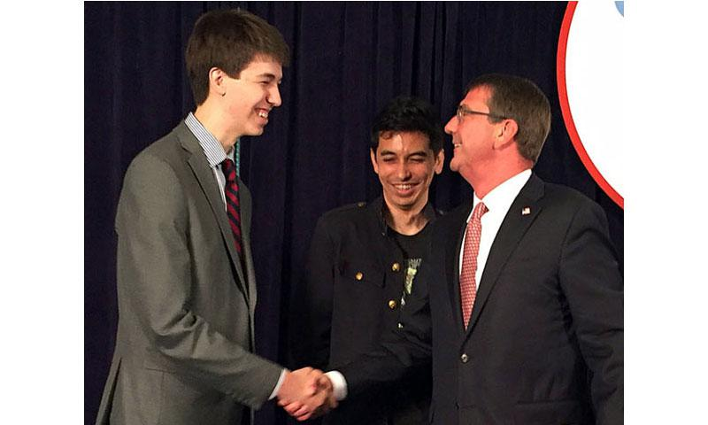 "Secretary of Defense Ash Carter on Friday, June 17, 2016, congratulates 18-year-old David Dworken, left, and Craig Arendt, 35, for finding six vulnerabilities in DODs websites during the department's ""Hack the Pentagon"" competition. (Tara Copp/Stars and Stripes)"