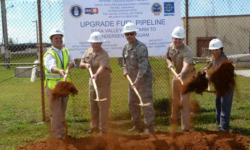Chris Matheis, construction executive, U.S. Navy Capt. Christopher Bower, Defense Logistics Agency Energy Pacific commander, U.S. Air Force Brig. Gen. Steven Garland, 36th Wing commander, U.S. Navy Cmdr. Kevin Juntenen, Naval Facilities Engineering Command Marianas Operations officer, and Nympha Garces, DLA Installation Support engineer, break ground on a new fuel pipeline with representatives from the Defense Logistics Agency June 6, 2014 on Andersen Air Force Base, Guam.