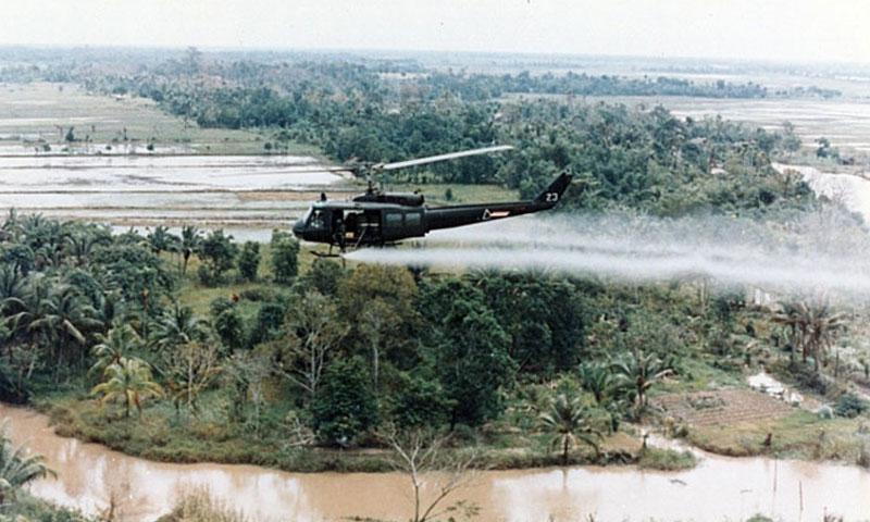 A U.S. Huey helicopter sprays Agent Orange over Vietnam. (U.S. Army)