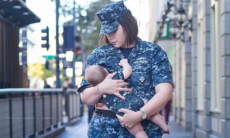 Petty Officer 2nd Class Amanda Langendoefer breast-feeds her baby on the streets of San Diego. In recent months, two military commands have tried to place restrictions on nursing mothers, only to rescind the policies days later. (Courtesy of Vanessa A. Simmons)