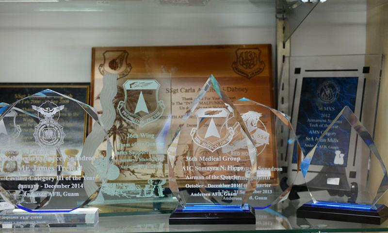 A number of plaques and rewards made by 36th Force Support Squadron Arts and Crafts Center members are on display June 10, 2015, at Andersen Air Force Base, Guam. The Arts and Crafts Center provides engraving and framing services as well as a wide variety of classes for people of all ages. (U.S. Air Force photo by Airman 1st Class Arielle Vasquez/Released)