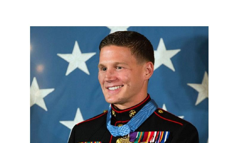 Retired Marine Corps Cpl. Kyle Carpenter smiles after receiving the Medal of Honor at the White House, June 19, 2014. (JOE GROMELSKI/STARS AND STRIPES)
