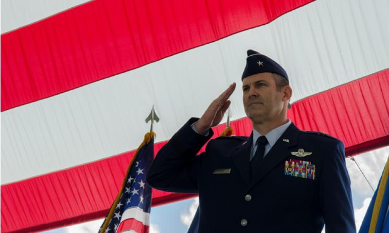 Brig. Gen. Andrew Toth, 36th Wing commander, performs his first salute to Team Andersen June 19, 2014, on Andersen Air Force Base, Guam. Toth assumed command of the wing from Brig. Gen. Steven Garland during a change of command ceremony. (U.S. Air Force photo by Senior Airman Katrina M. Brisbin/Released)