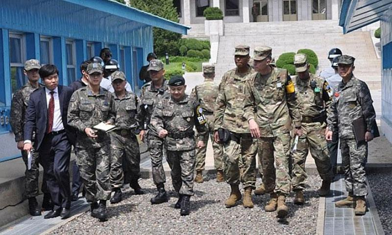 Gen. Vincent Brooks, U.S. Forces Korea commander, and Gen. Lee Soon-jim, of the South Korean joint chiefs of staff, receive a briefing at the Joint Security Area of the Demilitarized Zone Thursday, May 12, 2016. The South Korean government reported Monday that U.S. bases and a South Korean civilian appeared on a list of targets circulated by pro-Islamic State hackers. (Kim Gamel/Stars and Stripes)