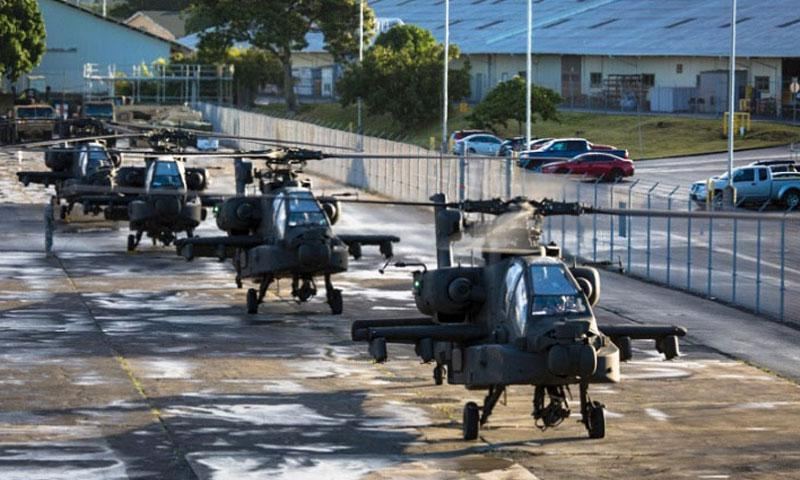 Four AH-64 Apache helicopters from the 16th Combat Aviation Brigade, 7th Infantry Division, land at Wheeler Army Airfield, Hawaii, Jan. 6, 2016. (Daniel Johnson/U.S. Army)