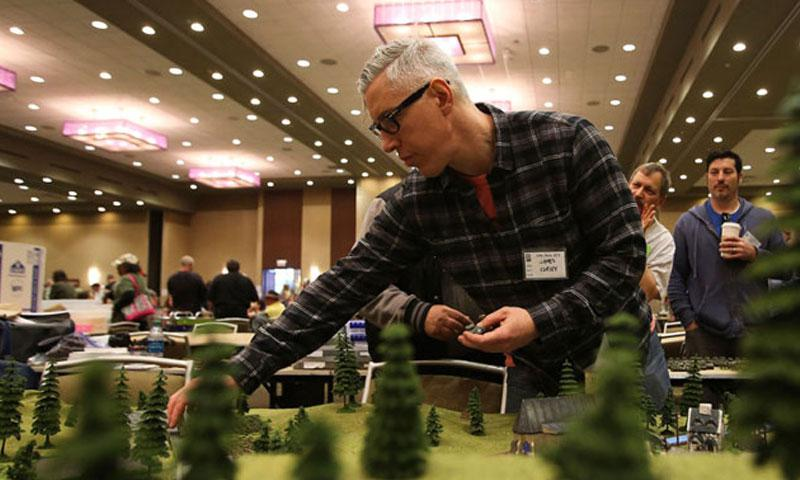 James Curley sets up his figures for St. Michel-Sur-Meurthe during the 2016 Little Wars Historical Miniatures Games Convention in Lombard, Illinois, on April 30, 2016. (Mike Mantucca, Chicago Tribune/TNS)