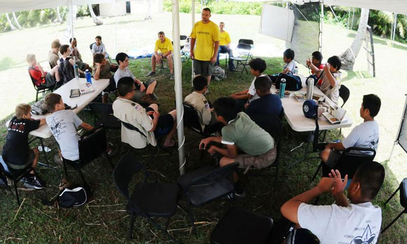 Boy Scouts from seven different troops on Guam participate in a group discussion about values during the annual Boy Scout Summer Camp on Andersen Air Force Base, Guam, June 19. 81 Boy Scouts and 26 adult volunteers participated in the camp focused on outdoor skills and character development. (U.S. Air Force photo by Airman 1st Class Mariah Haddenham/Released)