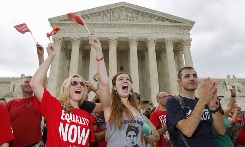 Supporters of gay marriage celebrate outside the Supreme Court on June 26, 2015 in Washington, D.C. The U.S. Supreme Court struck down bans on same-sex marriage in a historic 5-4 ruling. (Oliver Contreras/Zuma Press/TNS)