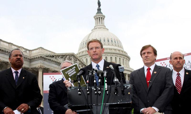 Tony Perkins, president of the Family Research Council, speaks at Tuesday's news conference on Capitol Hill. Behind him, left to right, are former Ohio Secretary of State Ken Blackwell, now with the FRC; retired Army chaplain Ron Crews (partly hidden) of the Chaplain Alliance for Religious Liberty; Rep. John Fleming, R-La.; and Rep. Louie Gohmert, R-Texas. (Joe Gromelski/Stars and Stripes)