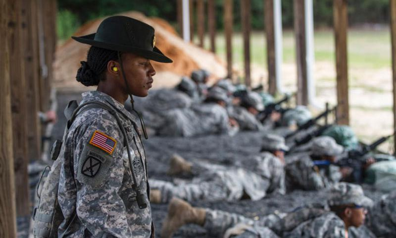 Army Reserve drill sergeant, Staff Sgt. Angelina Senghor, Company C, 1st Battalion, 518th Infantry Regiment, 98th Training Division, watches as a soldier finishes firing at the zero range on Fort Jackson, S.C. (Brian Hamilton/U.S. Army)