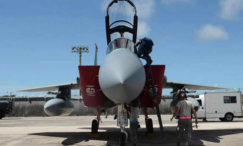 Airmen of the 44th Aircraft Maintenance Unit assigned to Kadena Air Base, Japan inspect an F-15C Eagle after a training mission June 27, 2014, on Andersen Air Force Base, Guam. The Airmen, aircraft and equipment came to Andersen to take part in an aviation training relocation program, which is an opportunity for Kadena Airmen to improve their skillsets in a location with less noise restrictions. (U.S. Air Force photo by Airman 1st Class Emily A. Bradley/Released)