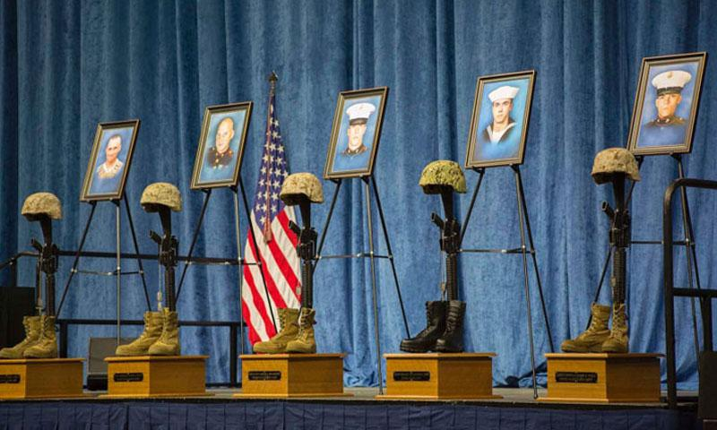 Battle crosses for fallen service members are displayed at the memorial service at University of Tennessee Chattanooga's McKenzie Arena in Chattanooga, Tenn., Aug. 15, 2015. (Kimberly Aguirre/U.S. Marine Corp)