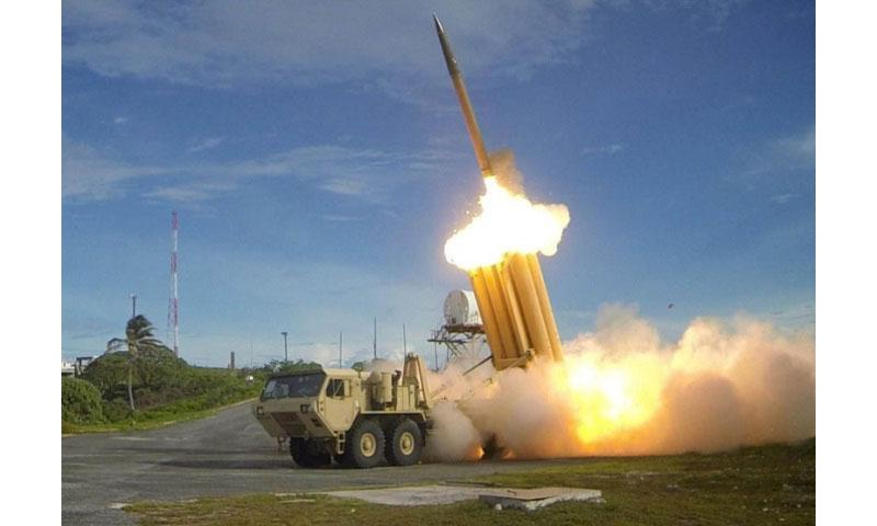 "The first of two Terminal High Altitude Area Defense, or THAAD, interceptors is launched during a successful intercept test in 2013. North Korea on Monday threatened to take a ""physical counter-action"" if the United States follows through with plans to deploy the advanced missile defense system on the peninsula. (Ralph Scott/Missile Defense Agency)"