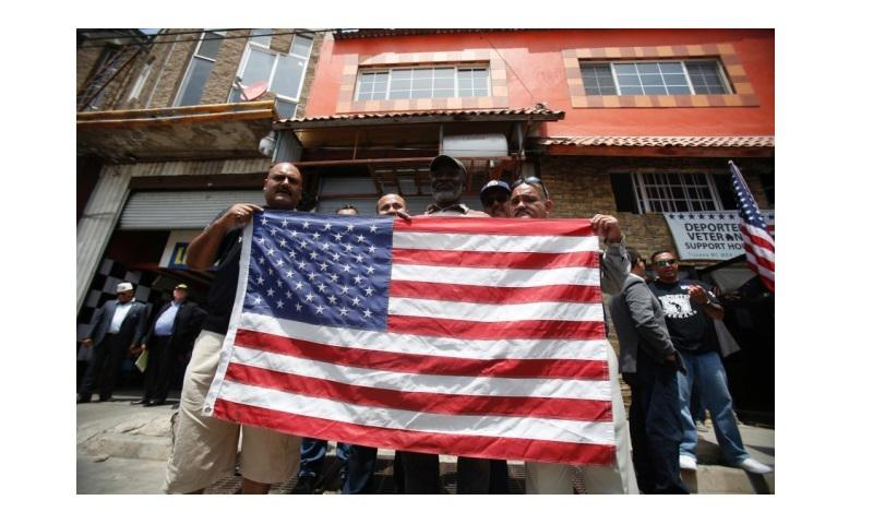 Deported veterans hold a U.S. flag in Tijuana, Mexico, on June 3, 2017 as seven members of Congress visited the Deported Veterans Support House. (ALEJANDRO TAMAYO/SAN DIEGO UNION-TRIBUNE/TNS)