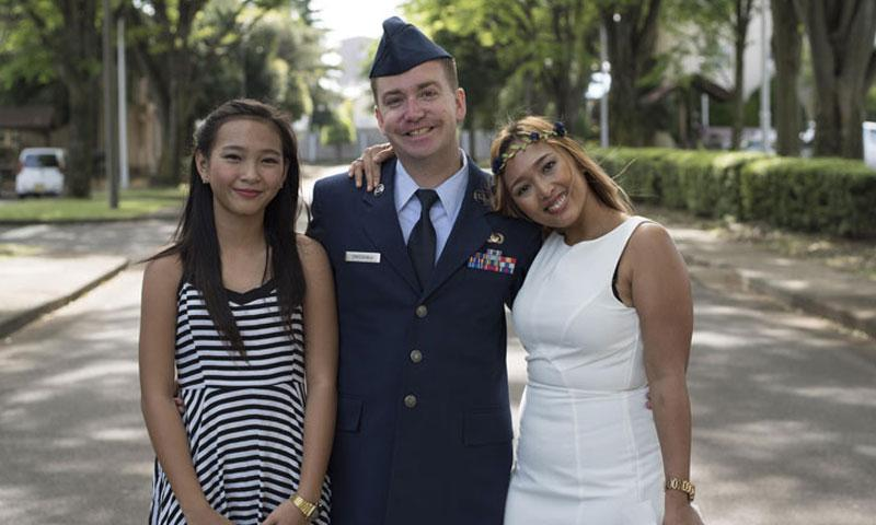 Joheart (right), Toni (left) and Senior Airman David Owsianka (center), 374th Airlift Wing Public Affairs photojournalist, pose for a picture at Yokota Air Base, Japan, May 7, 2016. (U.S. Air Force photo by Staff Sgt. Michael Washburn/Released)