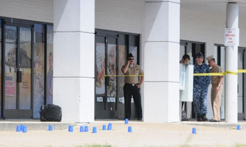 Reserve Recruitment personnel stand outside at Highway 153 and Lee Highway on Thursday, July 16, 2015, in Chattanooga, Tenn. Former senior military officers are urging caution in the wake of calls to arm domestic servicemembers following last week's deadly rampage in Tennessee. (Tim Barber, Chattanooga Times Free Press/TNS)