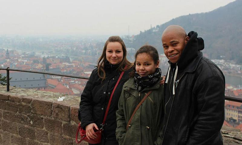 Amber Walker, then 10, stands between her parents, Claudia and Edmond, a U.S. Army staff sergeant, at Heidelberg Castle in Heidelberg, Germany, in 2013. Amber was killed on a ride at Holiday Park in Hassloch, Germany, in August 2014. German prosecutors announced this week that three park employees have been charged with negligent homicide in connection with Amber's death. Claudia Walker wants the park placed off-limits to U.S. military personnel in Europe. (Photo courtesy of Claudia Walker)