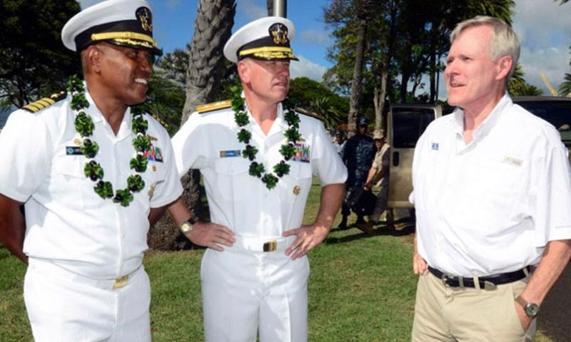 Secretary of the Navy Ray Mabus, right, is greeted by Capt. Stanley Keeve Jr., left, commander of Joint Base Pearl Harbor-Hickam, and Rear Adm. Rick Williams, commander of Navy Region Hawaii and Naval Surface Group Middle Pacific, as he arrives at Hospital Point at JBPHH for a groundbreaking and blessing ceremony for the Navy's largest solar generation system project in Hawaii, July 24, 2014. (JOHN M. HAGEMAN/U.S. NAVY)
