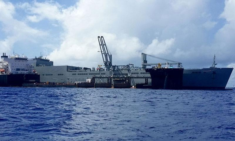 SAIPAN, North Mariana Islands (July 11, 2017) USNS RED CLOUD (T-AKR 313) and USNS MONTFORD POINT (ESD 1) conduct skin-to-skin (S2S) operations in waters off the coast of Saipan, North Mariana Islands, July 11. The two ships connected while MONFORD POINT acted as a floating pier for a simulated offload operation. The event displayed the two ship's ability to transfer large cargo at sea. (U.S. Navy photo/RELEASED)