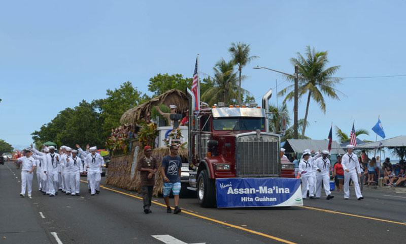 Sailors accompany residents of the village of Assan-Ma'ina along the parade route during the 72nd Liberation Day parade in Hagatna on July 21. (Photo by Tanya M. Champaco Mendiola, U.S. Navy)