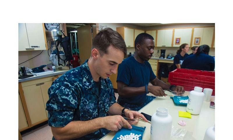 Hospital Corpsman 3rd Class Kory Alliton and Hospital Corpsman 3rd Class Roy Lightner package medications in preparation for the next mission stop aboard Military Sealift Command hospital ship USNS Comfort on July 24, 2015. The Defense Department has warned Congress that by the end of this week its health care system could run out of money to provide outside treatment for troops and dependents. (Brittney Cannady/U.S. Navy)