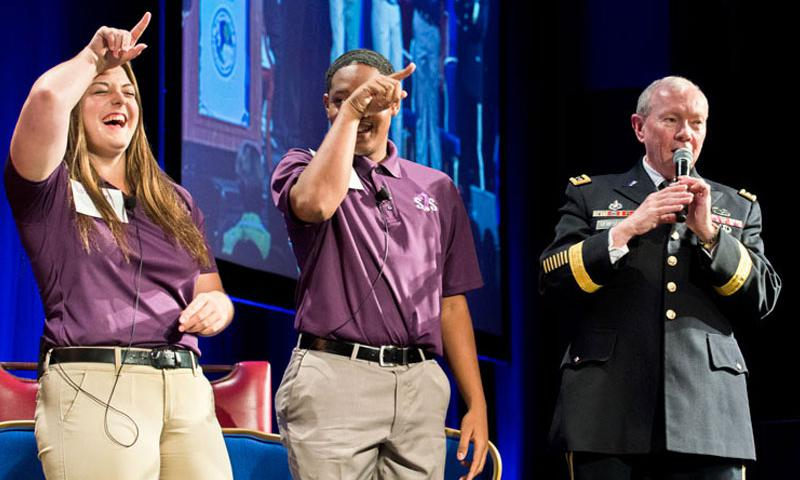 Army Gen. Martin E. Dempsey, chairman of the Joint Chiefs of Staff, sings a song at the Military Child Education Coalition's annual training seminar in Washington with six children selected for their work with the organization, July 29, 2014. The coalition works with national experts in child development, education and health to support military children. DoD photo by Navy Petty Officer 1st Class Daniel Hinton)