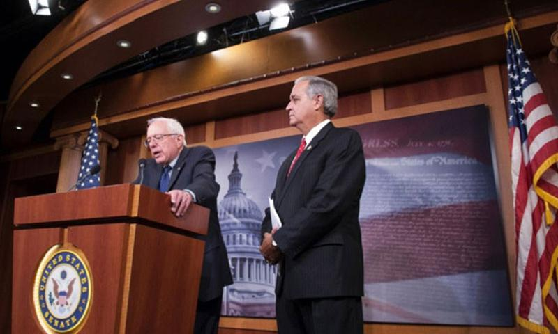 Sen. Bernie Sanders, I-Vt., left, and Rep. Jeff Miller, R-Fla,, talk about the VA reform bill Monday at the Capitol. (JOE GROMELSKI/STARS AND STRIPES)