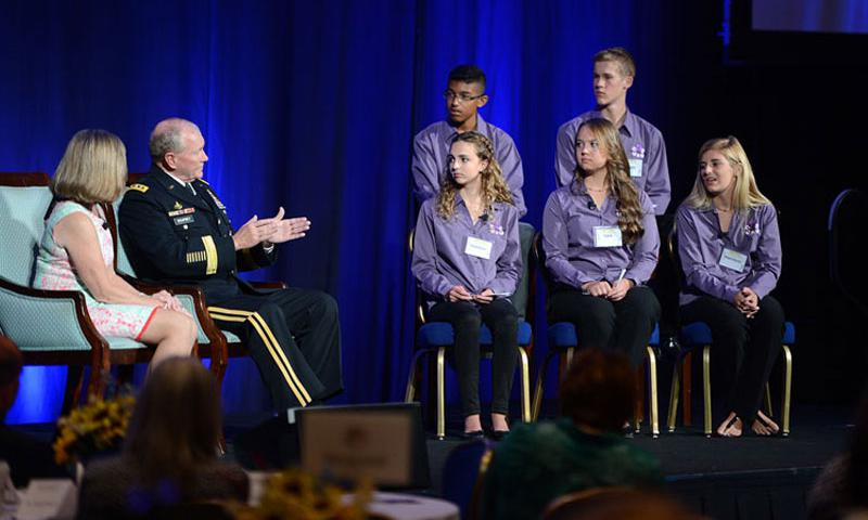 Army Gen. Martin E. Dempsey, chairman of the Joint Chiefs of Staff, and his wife, Deanie, take questions from Student 2 Student members, top row from left, Raul Rosales IV, 15, from San Antonio, Texas