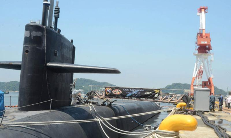 The USS Michigan is one of the Navy's four nuclear-powered Ohio-class guided-missile submarines. The Michigan, which is 560 feet long, is capable of conducting strike operations and supporting special operations missions. The submarine arrived at Yokosuka Naval Base on July 6, 2015, for a scheduled port visit. (Tyler Hlavac/Stars and Stripes)