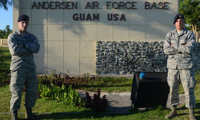Airmen 1st Class Colby (left) and Travis Wakefield, 36th Security Forces Squadron entry controllers, stand at the entry to Andersen Air Force Base, Guam, July 29, 2015. While they are brothers in arms who serve together, they are also fraternal twins who have worked together since entering the Air Force in October 2013. (U.S. Air Force photo by Airman 1st Class Alexa Ann Henderson/Released)