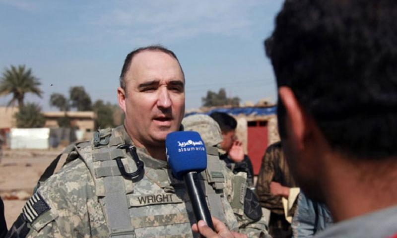 Then Lt. Col. Darron Wright gives an interview to local Iraqi media in Baghdad on Feb. 11, 2010. Wright, subsequently promoted to colonel, died in a parachute accident in N.C. in September 2013. (ADVIN ILLA-MEDINA/U.S. ARMY)